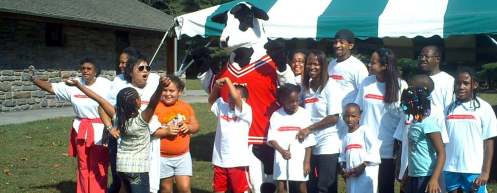 Group of kids with a cow mascot